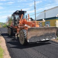 Строительство поселковых дорог